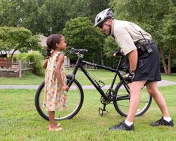 Bike Patrol Officer Talking to Girl