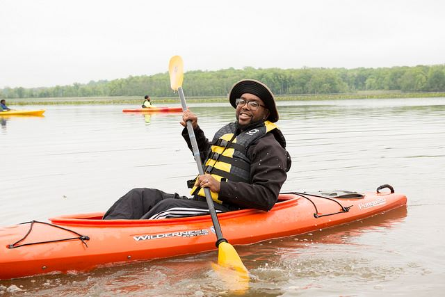A man in a kayaking