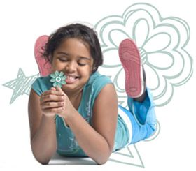 A girl laying on her stomach looking at a flower and smiling with a green flower graphic behind her.