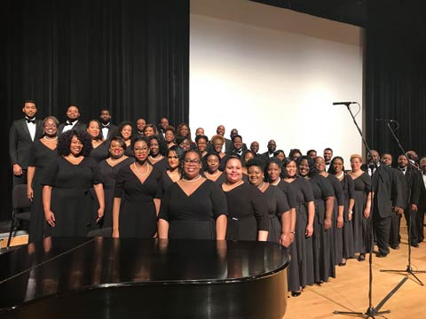 The Carter Legacy Singers wearing all black and posing in unison